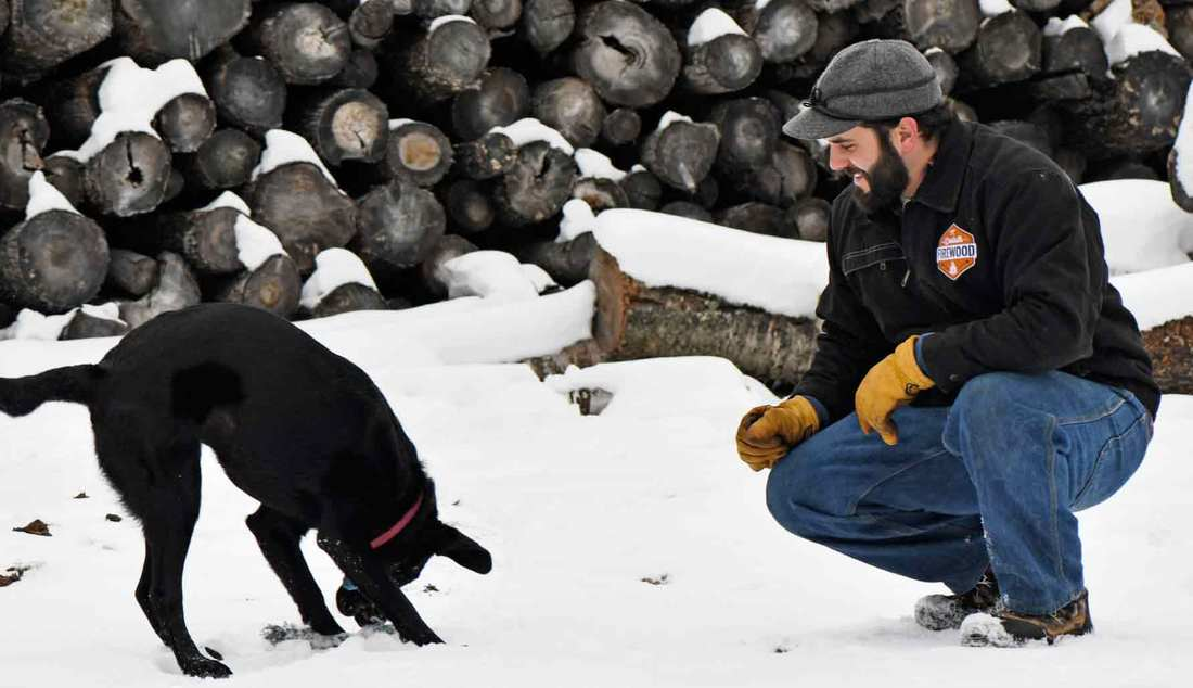 Duluth Firewood's Owner Wade Haworth and dog Maggie